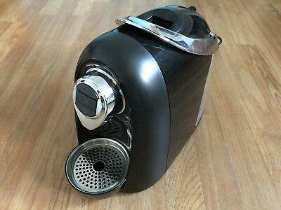 a black Kaldi SO4 coffee machine placed on kitchen bench